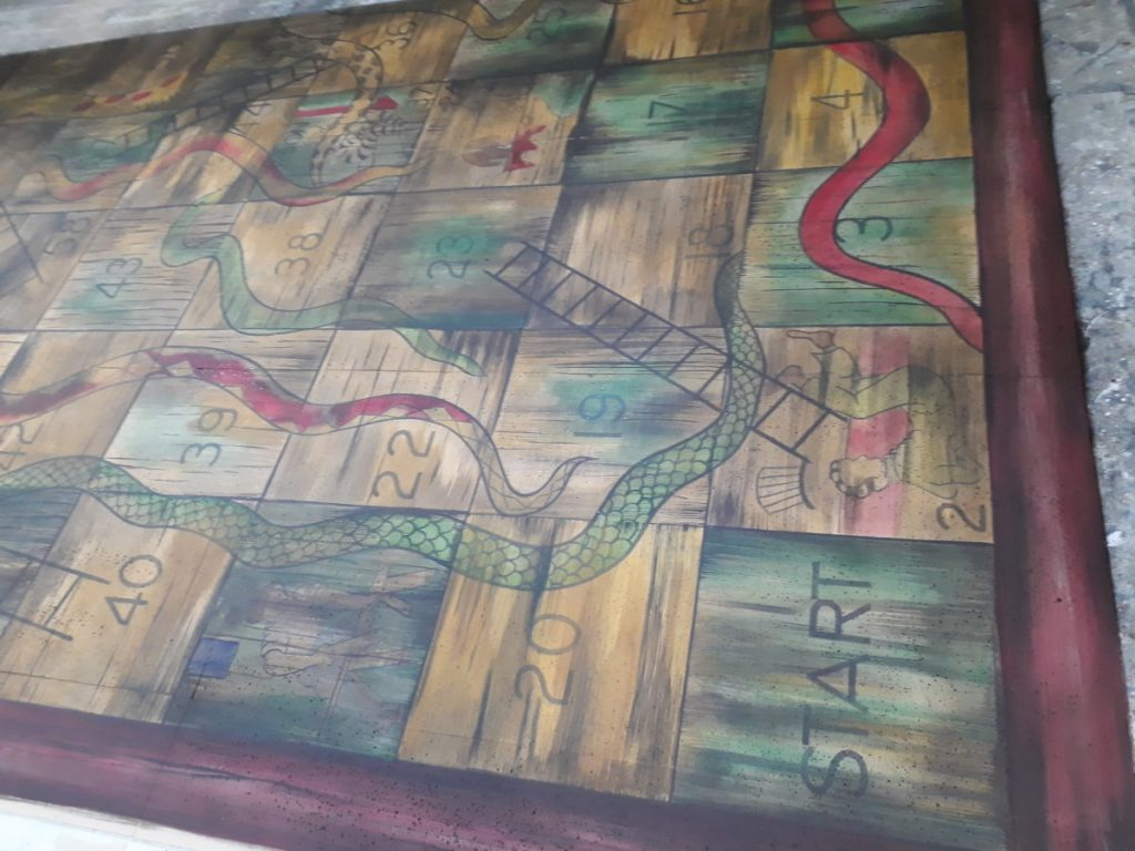 The Borrowers – the snakes and ladders painted floor pictured in DSH workshop