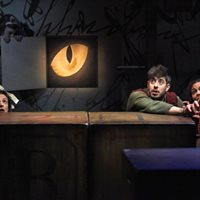 The Borrowers – production shot of the cat peering in to the little people!