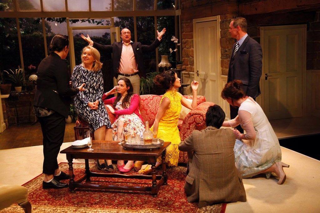 Production image of the interior set designed by Neil Irish at The Watermill Theatre