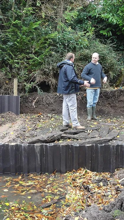 David Holland and the client discussing the ground works for the Stratford boathouse.
