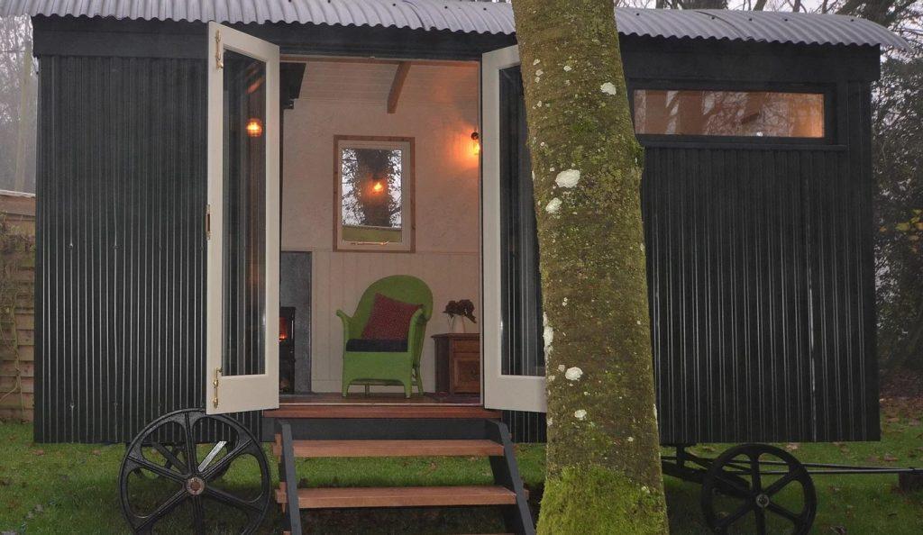 Shepherd Hut Exterior with view inside to Hobbit stove