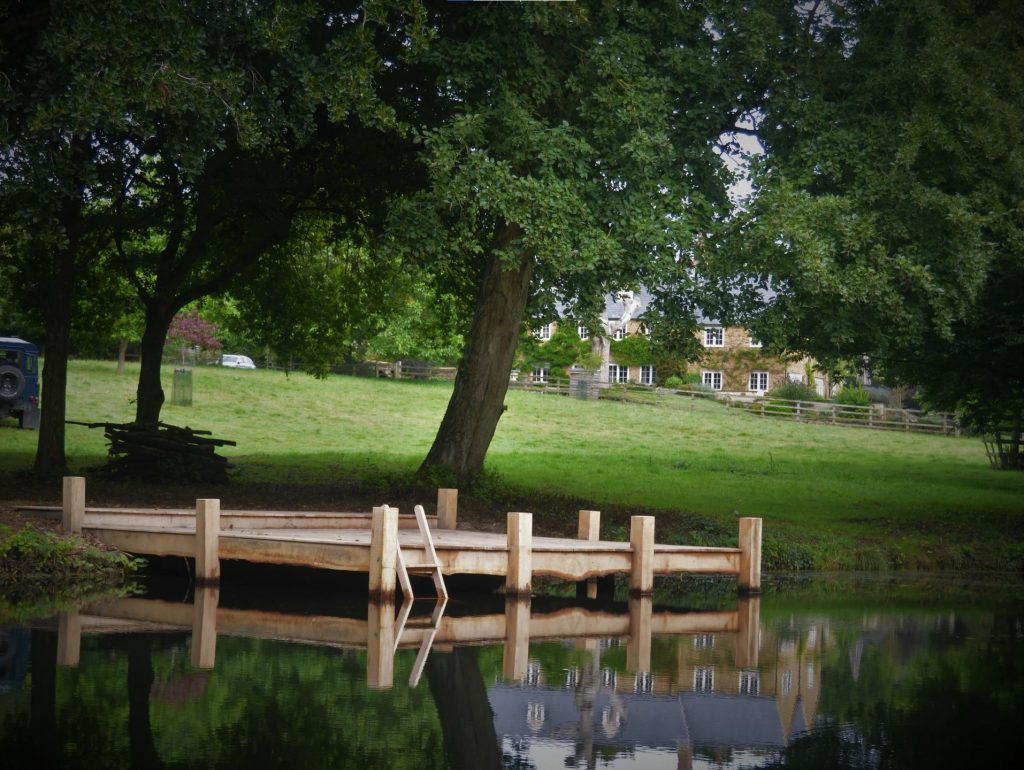 DSH Bespoke green oak Pond Jetty with access ladder for wild swimming