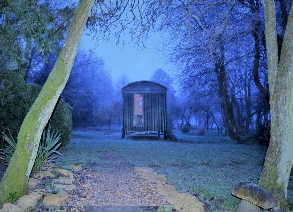 Wintery garden retreat. End view of Tew shepherd hut