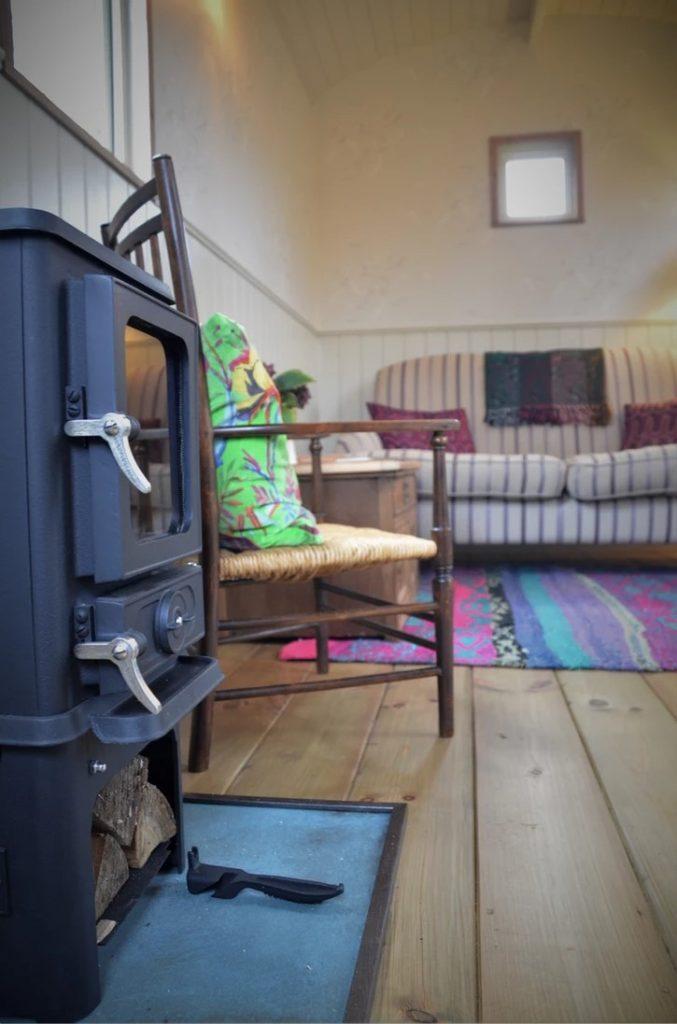 Shepherd Hut Hobbit Woodburner and reclaimed timber floorboards