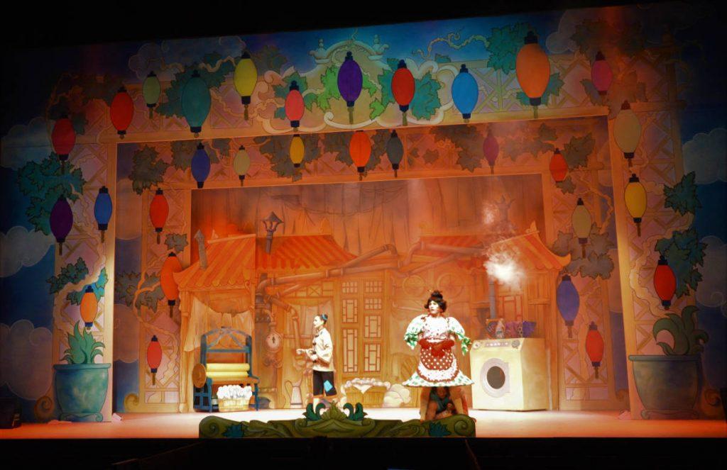 DSH Aladdin Set 2 widow Twankey's laundry scene with comdey mangle and stemaing washing machine effect. Pantomime set for hire.