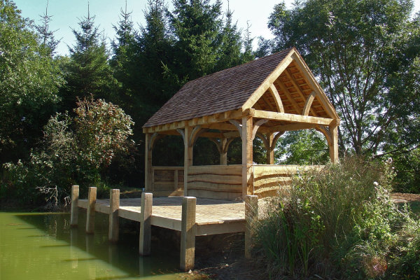 Green oak boat house and jetty designed and built by DSH