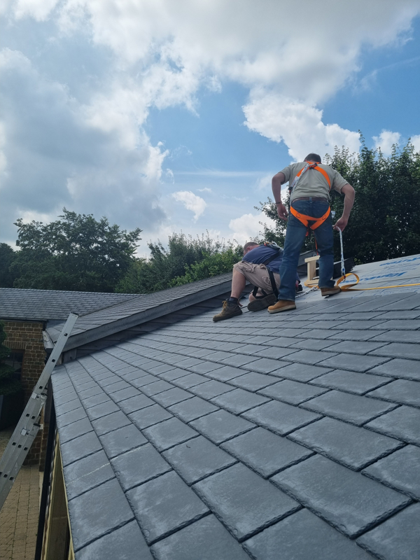 Tiling the roof of the barn extension.